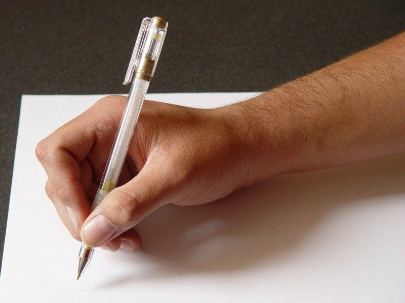 Ручка в руке